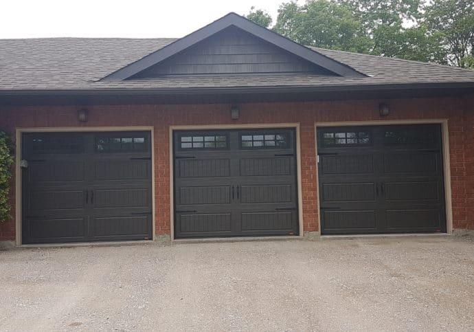 Garage Door Coach House in Brown With Windows